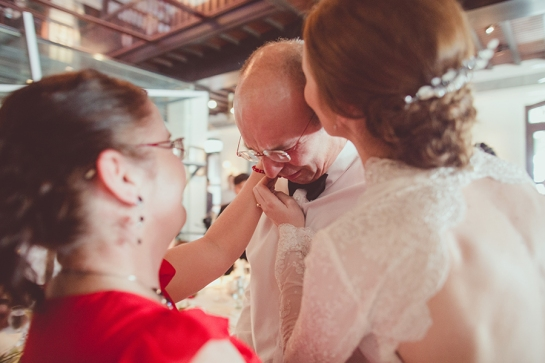 Singapore wedding bride embracing father with tears of joy